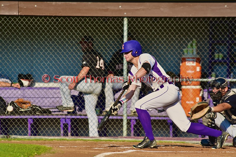 Cortland Crush Julian Gallup (9) bunts the ball against the Oneonta Outlaws in a NYCBL Playoff game on Greg's Field at Beaudry Park in Cortland, New York on Monday, July 27, 2015. Cortland won 4-3.