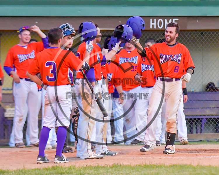 Cortland Crush David Murphy (8) is greeted at home plate after hitting a home run against the Sherrill Silversmiths on Greg's Field at Beaudry Park in Cortland, New York on Tuesday May 31, 2016. Cortland won 16-3.