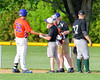 Cortland Crush Athletic Trainer Anthony Spinelli attends to Andrew Taft (32) duirng the game against the Sherrill Silversmiths on Greg's Field at Beaudry Park in Cortland, New York on Tuesday May 31, 2016. Cortland won 16-3.