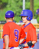 Cortland Crush Third Base Coach talkes with Patrick Messinger (14) during a time out against the Sherrill Silversmiths on Greg's Field at Beaudry Park in Cortland, New York on Tuesday May 31, 2016. Cortland won 16-3.