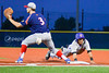 Cortland Crush Josua Lopez (21) dives back to First Base to beat the tag against the Syracuse Junior Chiefs in Syracuse, New York on Thursday June 2, 2016. Cortland won 6-0.