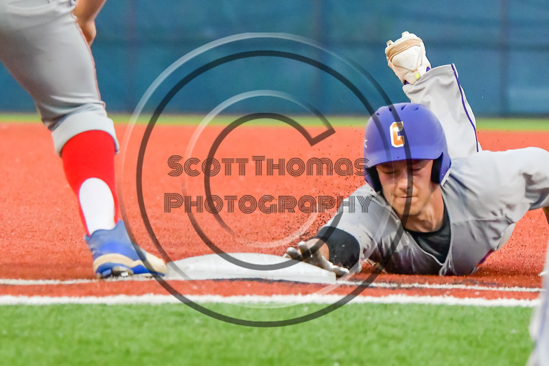 Cortland Crush Anthony Searles (2) gets back to First Base before the tag against the Syracuse Junior Chiefs in Syracuse, New York on Thursday June 2, 2016. Cortland won 6-0.