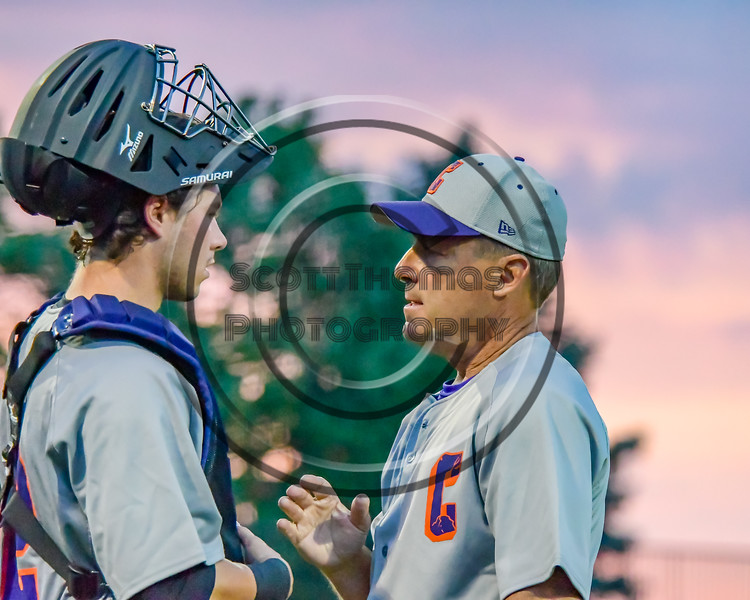 Cortland Crush Manager Bill McConnell talks with his catcher between innings in a game against the Syracuse Junior Chiefs in Syracuse, New York on Thursday June 2, 2016. Cortland won 6-0.