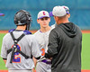 Cortland Crush Pitching Coach Daniel Payne (44) talks with the starting pitcher Andrew Cartier (23) during a game against the Syracuse Junior Chiefs in Syracuse, New York on Thursday June 2, 2016. Cortland won 6-0.