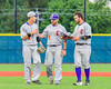 Cortland Crush Third Base Coach John Buczek (9, center) talks with players against the Syracuse Junior Chiefs in Syracuse, New York on Thursday June 2, 2016. Cortland won 6-0.