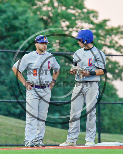 Cortland Crush Anthony Searles (2) talks with Third Base Coach John Buczek (9) in the game agianst the Syracuse Junior Chiefs in Syracuse, New York on Thursday June 2, 2016. Cortland won 6-0.