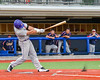 Cortland Crush Ethan Moore (16) kicks up synthetic dirt with a hit against the Syracuse Junior Chiefs in Syracuse, New York on Thursday June 2, 2016. Cortland won 6-0.