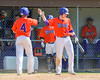 Cortland Crush Joey Assenza (4) gets a high five from Derek Martin (29) after scoring a run agianst the Rome Generals on Greg's Field at Beaudry Park in Cortland, New York on Saturday June 4, 2016. Cortland won 9-5.