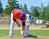Cortland Crush Tom Cockill (38) painting the pitcher's rubber before a game against the Rome Generals on Greg's Field at Beaudry Park in Cortland, New York on Saturday June 4, 2016.