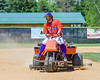 Cortland Crush Nathan Verst (24) dragging the infield before a game against the Rome Generals on Greg's Field at Beaudry Park in Cortland, New York on Saturday June 4, 2016.