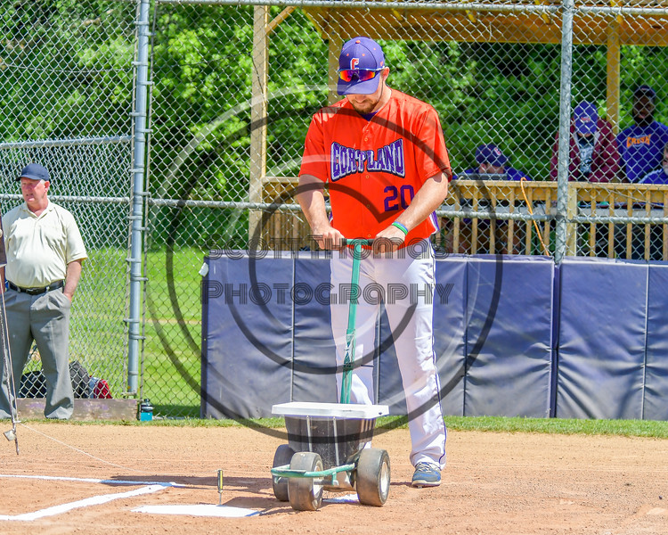 Cortland Crush Tommy Seaver (20) lining home plate before a game against the Rome Generals on Greg's Field at Beaudry Park in Cortland, New York on Saturday June 4, 2016.