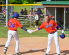 Cortland Crush George Haaland (34) gets congratulated by Ethan Moore (16) as he scores a run against the Rome Generals on Greg's Field at Beaudry Park in Cortland, New York on Saturday June 4, 2016. Cortland won 9-5.