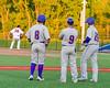 Cortland Crush David Murphy (8), Third Base Coach John Buczek (9) and Derek Martin (29) watch as Syracuse Salt Cats Pitcher Garrett Pelko (16) warms up at OCC Turf Field in Syracuse, New York on Monday, June 6, 2016. Cortland won 4-2.