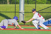 Cortland Crush David Murphy (8) dives back to First Base as Syracuse Salt Cats Joseph Anselmi (22) gets ready to field the ball at OCC Turf Field in Syracuse, New York on Monday, June 6, 2016. Cortland won 4-2.