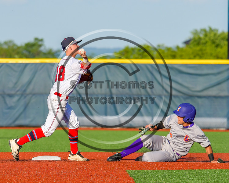 Cortland Crush Joey Assenza (4) gets forced out by Syracuse Salt Cats Thomas Burke (28) at OCC Turf Field in Syracuse, New York on Monday, June 6, 2016. Cortland won 4-2.