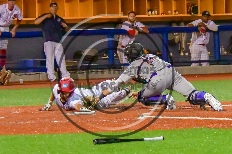 Cortland Crush Catcher Anthony Searles (2) tags the Syracuse Salt Cats runner out at OCC Turf Field in Syracuse, New York on Monday, June 6, 2016. Cortland won 4-2.