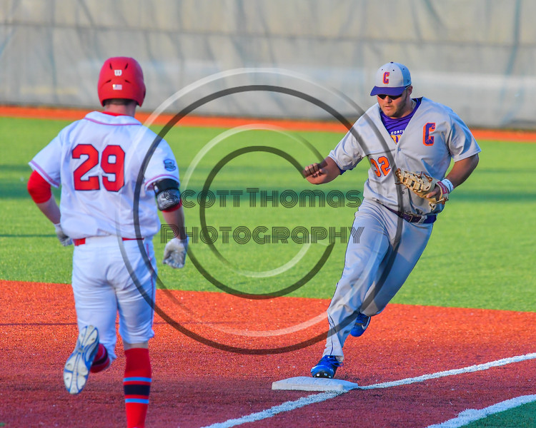 Cortland Crush Andrew Taft (32) forces out Syracuse Salt Cats Justin Clark (29) at OCC Turf Field in Syracuse, New York on Monday, June 6, 2016. Cortland won 4-2.