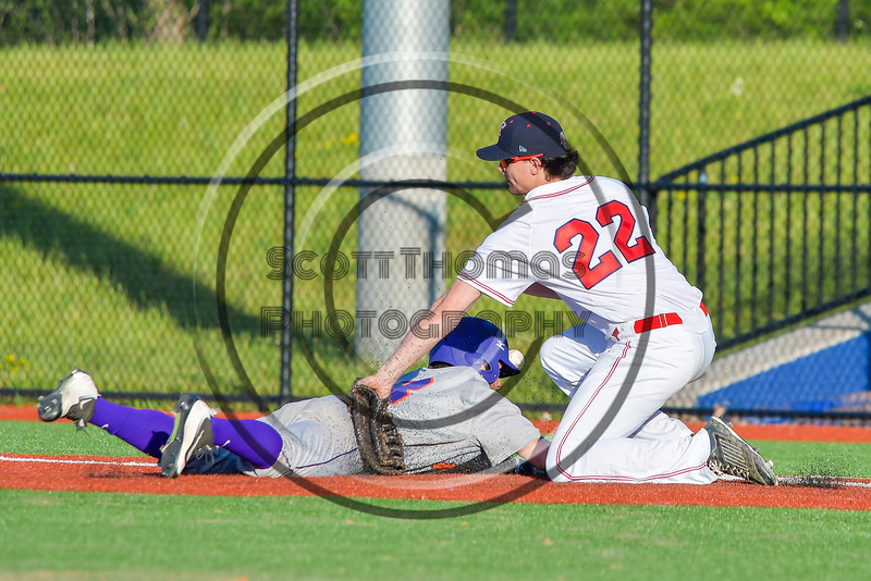 Cortland Crush David Murphy (8) is safe at First Base as Syracuse Salt Cats Joseph Anselmi (22) has the ball get away from him at OCC Turf Field in Syracuse, New York on Monday, June 6, 2016. Cortland won 4-2.