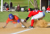 Cortland Crush Broderick Santilli (3) beats the tag at Third Base against the Capitol City Reds on Greg's Field at Beaudry Park in Cortland, New York on Thursday, June 9, 2016. Capitol City won 4-2.