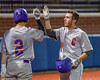 Cortland Crush Broderick Santilli (3) receives High Fives after scoring what would be the winning run at the top of the 10th inning against the Syracuse Salt Cats at OCC Turf Field in Syracuse, New York on Wednesday, June 15, 2016. Cortland won 5-2.