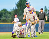 Cortland Crush Patrick Messinger (14) helps Stephan Witkowski (17) up from the turf after catching a pop up against the Syracuse Salt Cats at OCC Turf Field in Syracuse, New York on Wednesday, June 15, 2016. Cortland won 5-2.