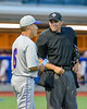 Cortland Crush Manager Bill McConnell talks with the Home Plate Umpire between innings against the Syracuse Salt Cats at OCC Turf Field in Syracuse, New York on Wednesday, June 15, 2016. Cortland won 5-2.