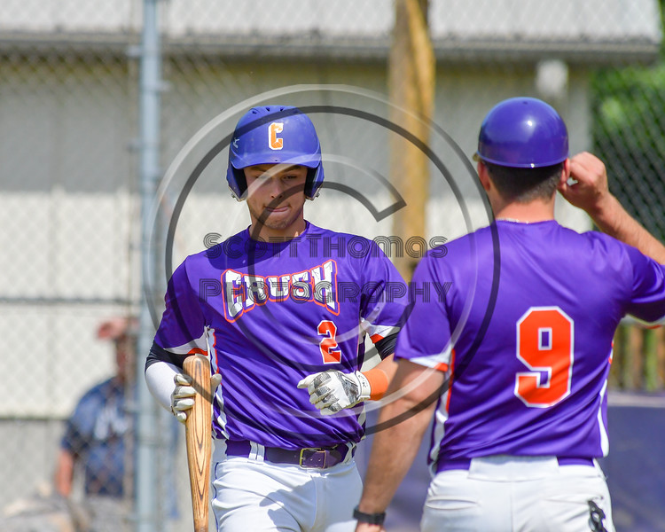 Cortland Crush Anthony Searles (2) talks with his Third Base Coach John Buczek (9) before an at bat against the Hornell Dodgers on Greg's Field at Beaudry Park in Cortland, New York on Saturday, June 18, 2016. Hornell won 11-3.