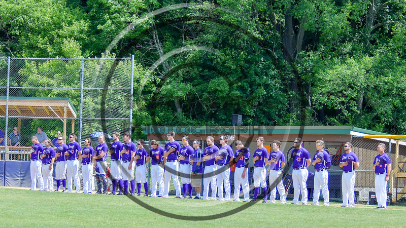 Cortland Crush stand on the Third Base line during the National Anthem before playing the Hornell Dodgers on Greg's Field at Beaudry Park in Cortland, New York on Saturday, June 18, 2016.