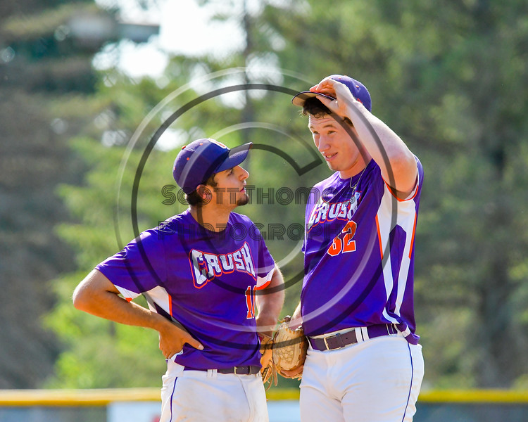 Cortland Crush Paul Ludden (10) talks with Aaron Edelmon (62) during a time out against the Hornell Dodgers on Greg's Field at Beaudry Park in Cortland, New York on Saturday, June 18, 2016. Hornell won 11-3.
