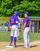 Cortland Crush Josua Lopez (21) gets a fist bump from Third Base Coach John Buczek (9) against the Hornell Dodgers on Greg's Field at Beaudry Park in Cortland, New York on Saturday, June 18, 2016. Hornell won 11-3.