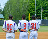 Cortland Crush players Paul Ludden (10), David Murphy (8) and Josua Lopez (21) during the National Anthem before playing the Syracuse Junior Chiefs on Greg's Field at Beaudry Park in Cortland, New York on Sunday, June 19, 2016.