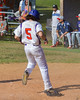 Cortland Crush Luke Gilbert (5) scores the tying run against the Syracuse Junior Chiefs on Greg's Field at Beaudry Park in Cortland, New York on Sunday, June 19, 2016. Cortland won 6-5.