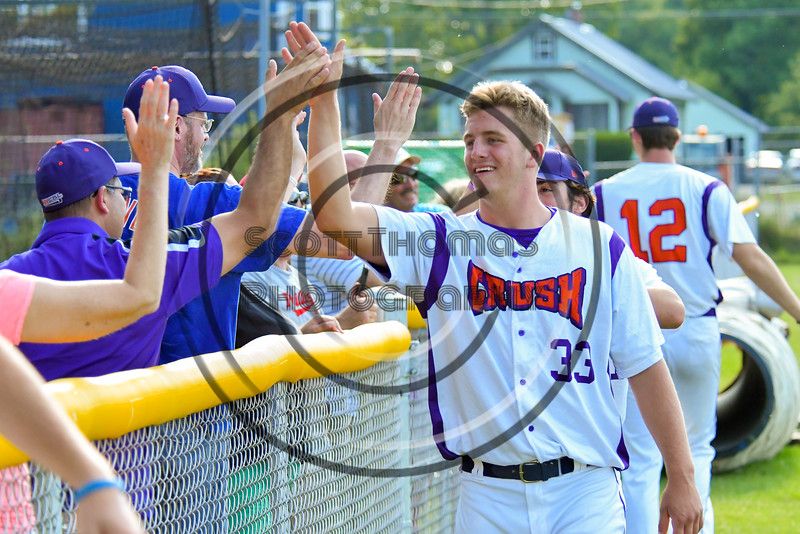Cortland Crush Blake Demeter (33) celebrates with fans after beating the Syracuse Junior Chiefs on Greg's Field at Beaudry Park in Cortland, New York on Sunday, June 19, 2016. Cortland won 6-5.