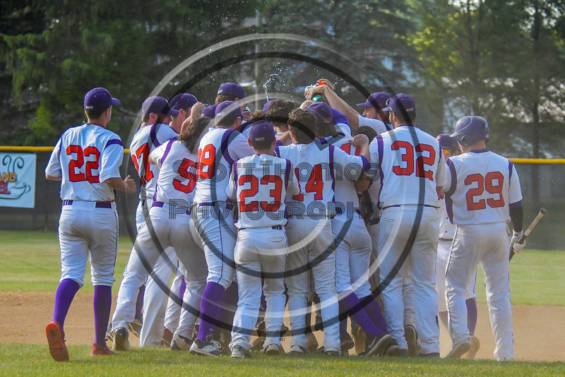 Cortland Crush mob David Murphy (8) after his walk off hit to win the game against the Syracuse Junior Chiefs on Greg's Field at Beaudry Park in Cortland, New York on Sunday, June 19, 2016. Cortland won 6-5.