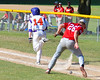 Cortland Crush Patrick Messinger (14) runs up the First Base line after a bunt against the Syracuse Junior Chiefs on Greg's Field at Beaudry Park in Cortland, New York on Sunday, June 19, 2016. Cortland won 6-5.