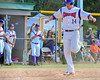 Cortland Crush Patrick Messinger (14) scores the winning run as his coaches and Crush fans cheer against the Syracuse Junior Chiefs on Greg's Field at Beaudry Park in Cortland, New York on Sunday, June 19, 2016. Cortland won 6-5.