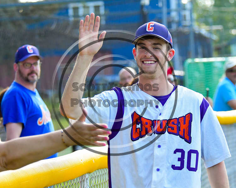 Cortland Crush William Ginsberg (30) celebrates with fans after beating the Syracuse Junior Chiefs on Greg's Field at Beaudry Park in Cortland, New York on Sunday, June 19, 2016. Cortland won 6-5.