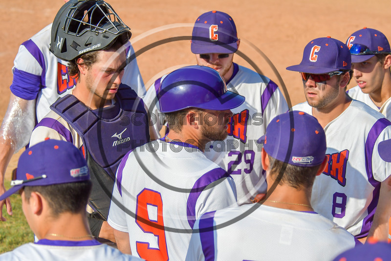 Cortland Crush Third Base Coach John Buczek (9) talks with the Crush players before their at bat at the bottom of the 9th inning against the Syracuse Junior Chiefs on Greg's Field at Beaudry Park in Cortland, New York on Sunday, June 19, 2016. Cortland won 6-5.