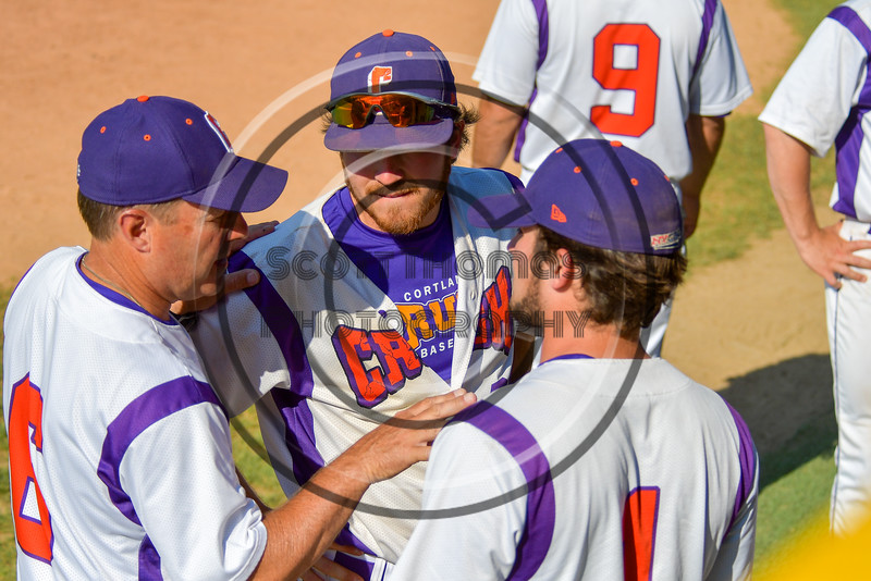 Cortland Crush Manager Bill McConnell talks with his players before an at bat against the Syracuse Junior Chiefs on Greg's Field at Beaudry Park in Cortland, New York on Sunday, June 19, 2016. Cortland won 6-5.