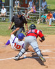 Cortland Crush Paul Ludden (10) slides into Home Base past Syracuse Junior Chiefs Joe DeLuca (25) on Greg's Field at Beaudry Park in Cortland, New York on Sunday, June 19, 2016. Cortland won 6-5.