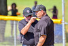 Umpires dicussing a call during the game between the Cortland Crush and Syracuse Junior Chiefs on Greg's Field at Beaudry Park in Cortland, New York on Sunday, June 19, 2016. Cortland won 6-5.