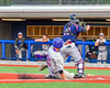 Syracuse Junior Chiefs Matthew Kleinstein (18) forces the out at Home Base against the  Cortland Crush at OCC Turf Field in Syracuse, New York on Wednesday, June 22, 2016. Cortland won 6-2.