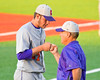 Cortland Crush Manager Bill McConnell fist bumps with his starting pitcher, Stephan Witkowski (17), after an inning against the Syracuse Junior Chiefs at OCC Turf Field in Syracuse, New York on Wednesday, June 22, 2016. Cortland won 6-2.