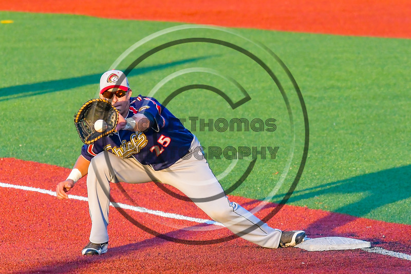 Syracuse Junior Chiefs Joe DeLuca (25) catches the ball for a force out at First Base against the Cortland Crush at OCC Turf Field in Syracuse, New York on Wednesday, June 22, 2016. Cortland won 6-2.