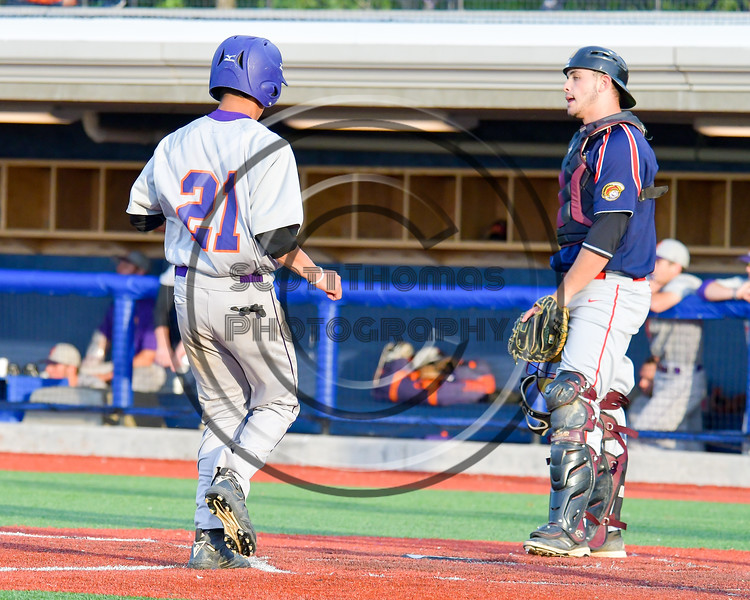 Cortland Crush Josua Lopez (21) scores a run against the Syracuse Junior Chiefs at OCC Turf Field in Syracuse, New York on Wednesday, June 22, 2016. Cortland won 6-2.