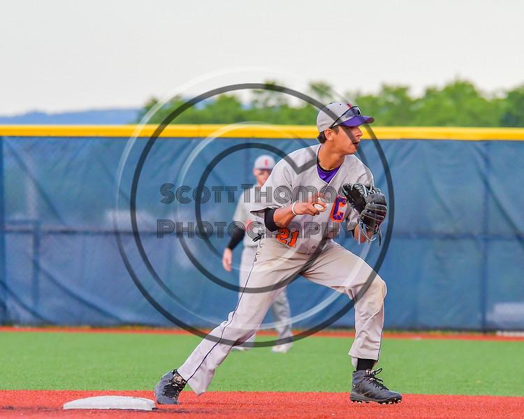 Cortland Crush Josua Lopez (21) fields the ball agains the Syracuse Junior Chiefs at OCC Turf Field in Syracuse, New York on Wednesday, June 22, 2016. Cortland won 6-2.