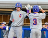 Cortland Crush Broderick Santilli (3) receives a high five from Derek Martin (29) after scoring the first run against the Syracuse Junior Chiefs at OCC Turf Field in Syracuse, New York on Wednesday, June 22, 2016. Cortland won 6-2.