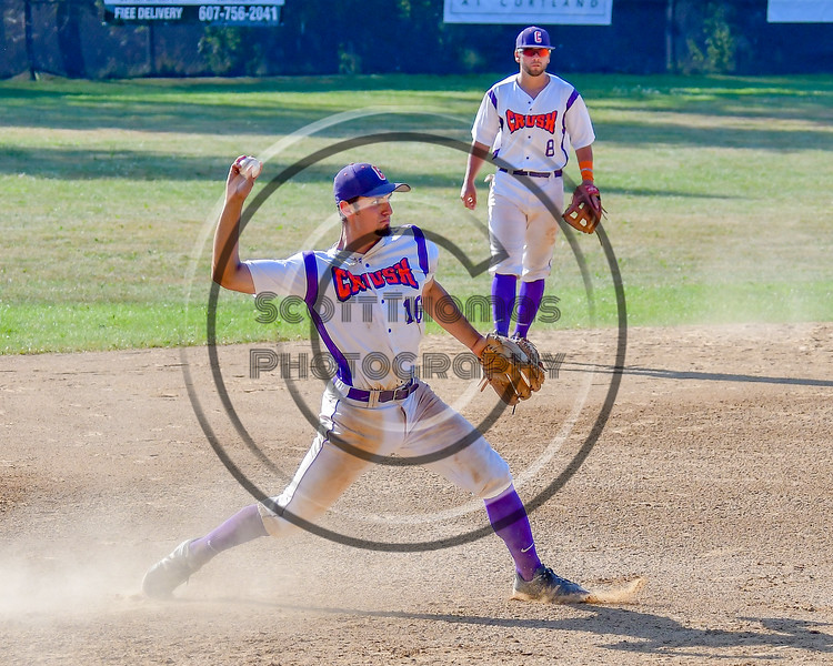Cortland Crush Paul Ludden (10) throws the ball to First Base for the final out against the Sherrill Silversmiths on Greg's Field at Beaudry Park in Cortland, New York on Sunday, June 26, 2016. Cortland won 6-4.