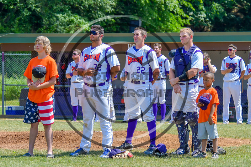 Cortland Crush players Andrew Taft (32), Dylan Leahy (22) and Evan Moore (13) during the National Anthem before playing the Sherrill Silversmiths on Greg's Field at Beaudry Park in Cortland, New York on Sunday, June 26, 2016.