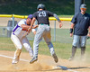 Cortland Crush Andrew Taft (32) tags Sherrill Silversmiths Mackay Williams (29) out on Greg's Field at Beaudry Park in Cortland, New York on Sunday, June 26, 2016. Cortland won 6-4.